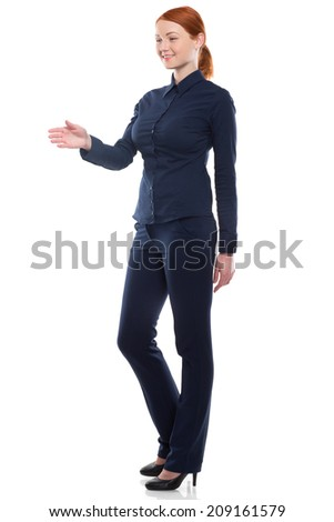 Full-length portrait of businesswoman handshaking, isolated on white. Concept of leadership and success - stock photo