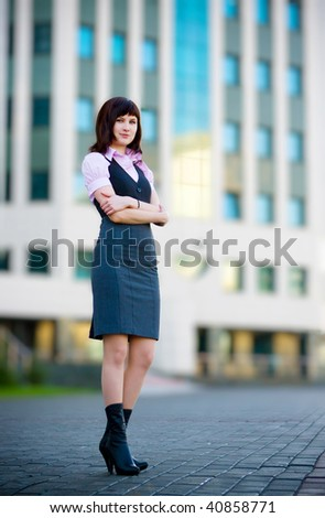 full-length portrait of businesswoman on the street - stock photo