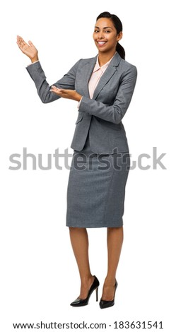 Full length portrait of businesswoman presenting an invisible product against white background. Vertical shot. - stock photo