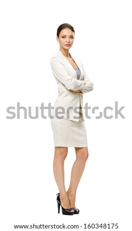 Full-length portrait of businesswoman with her hands crossed, isolated on white. Concept of leadership and success - stock photo