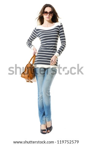 full-length portrait of casual fashion woman in sunglasses with bag posing in studio - stock photo