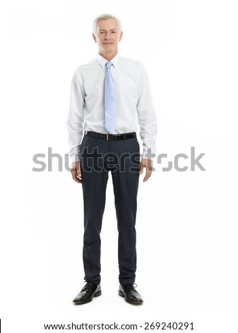 Full length portrait of casual sales man standing against white background while looking at camera.  - stock photo
