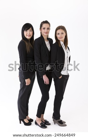 Full-length Portrait of Caucasian and Chinese business women. Isolated on white background. - stock photo