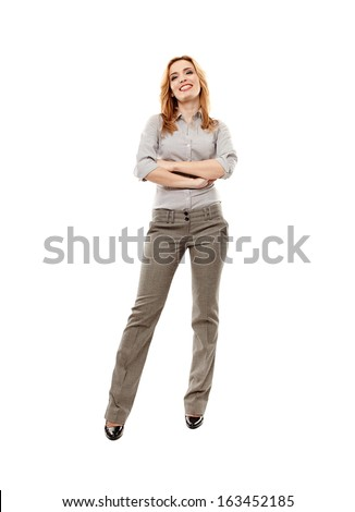 Full length portrait of cheerful businesswoman with arms folded, isolated on white background - stock photo