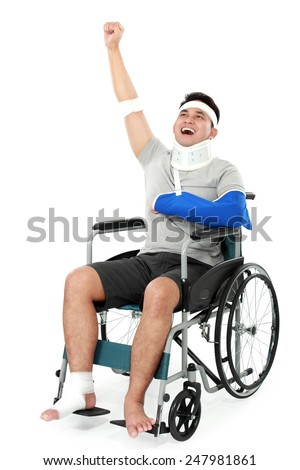 full length portrait of cheerful injured young man raise his hand - stock photo