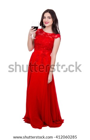 full length portrait of cheerful woman in red dress with glass of wine isolated on white background - stock photo