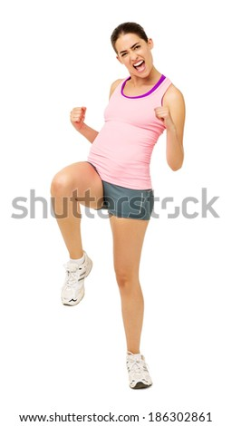 Full length portrait of cheerful young woman performing Zumba dance over white background. Vertical shot. - stock photo