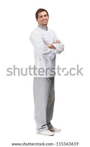 Full length portrait of chef cook with arms crossed, isolated on white - stock photo