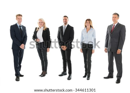 Full length portrait of confident business people standing against white background - stock photo