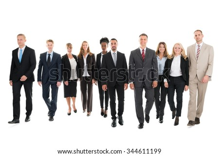 Full length portrait of confident business team walking against white background