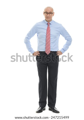 Full length portrait of confident businessman standing against white background.  - stock photo