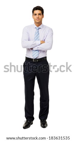 Full length portrait of confident businessman with arms crossed standing isolated over white background. Vertical shot.