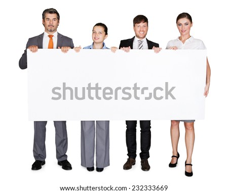 Full length portrait of confident businesspeople displaying large billboard over white background - stock photo