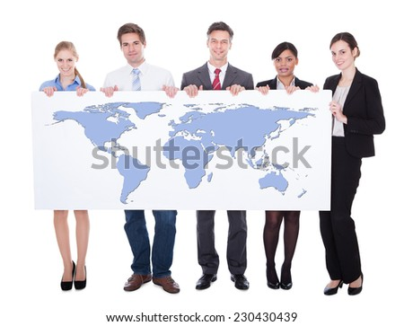 Full length portrait of confident businesspeople holding worldmap against white background. - stock photo