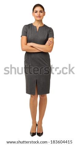 Full length portrait of confident businesswoman standing arms crossed over white background. Vertical shot. - stock photo