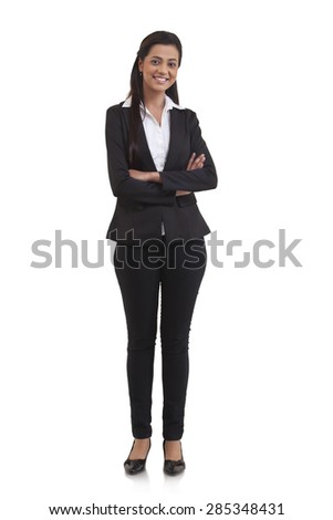 Full length portrait of confident businesswoman with arms crossed isolated over white background