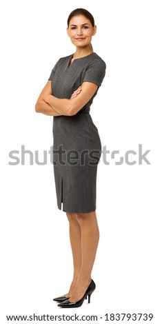 Full length portrait of confident businesswoman with arms crossed over white background. Vertical shot. - stock photo