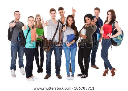 Full length portrait of confident college students standing together against white background - stock photo