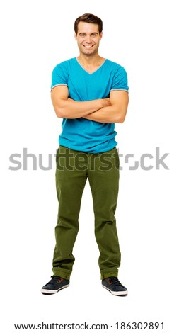 Full length portrait of confident man in casuals standing arms crossed against white background. Vertical shot. - stock photo