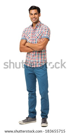Full length portrait of confident man standing arms crossed over white background. Vertical shot. - stock photo