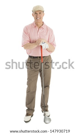 Full length portrait of confident mature man with golf club standing against white background - stock photo