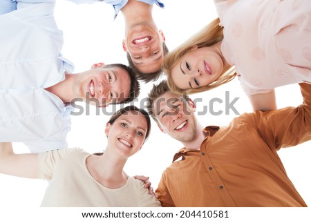 Full length portrait of confident young people standing together over white background