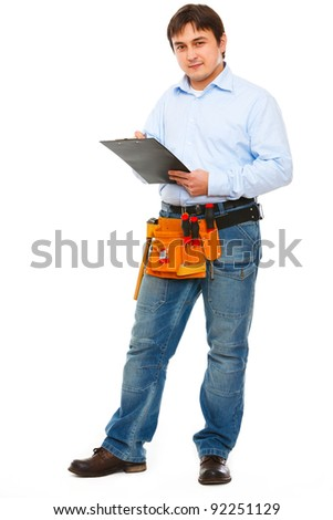 Full length portrait of construction worker with clipboard - stock photo