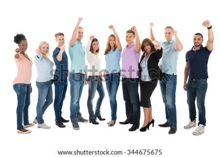Full length portrait of creative business team celebrating success against white background - stock photo