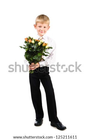 full length portrait of cute boy 5-7 years old holding roses isolated over white background - stock photo