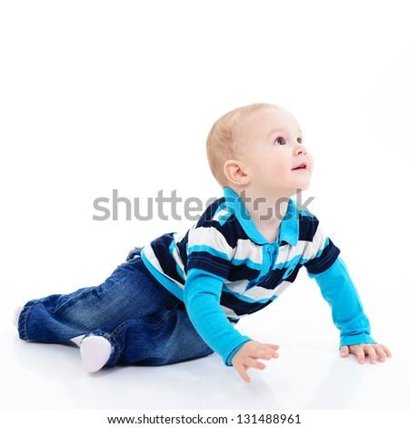 full length portrait of cute happy smiling little boy toddler sitting in studio, 11 month, studio over white - stock photo