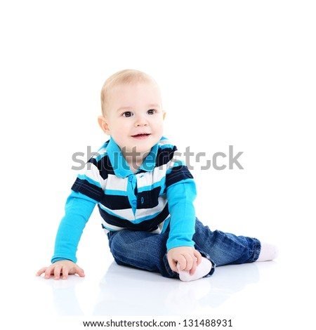 full length portrait of cute happy smiling sitting  little boy toddler, 11 month, studio over white - stock photo
