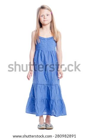 Full length portrait of cute little girl in blue dress. Isolated on white. - stock photo