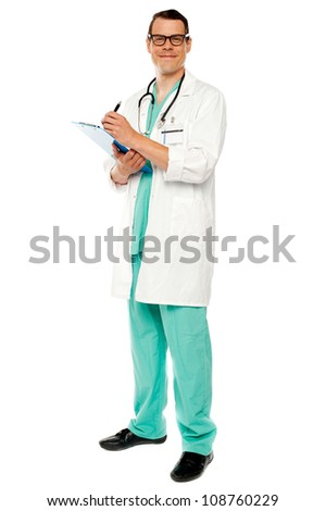 Full length portrait of doctor writing  medical prescription isolated on white - stock photo
