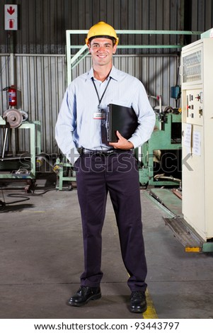 full length portrait of factory technical manager - stock photo