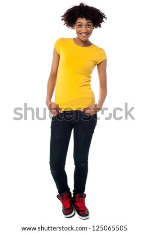 Full length portrait of fashion woman in trendy casuals isolated on white background.
