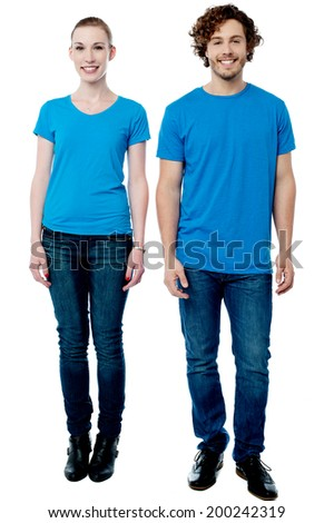 Full length portrait of fashionable young couple - stock photo