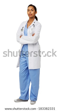 Full length portrait of female doctor with arms crossed standing over white background. Vertical shot.