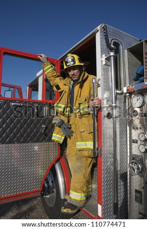 Full length portrait of firefighter - stock photo