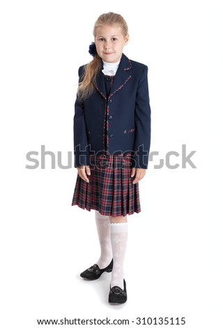 Full length portrait of first grade Caucasian pupil in school uniform, girl isolated on white background