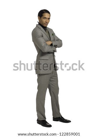 Full length portrait of good looking well dressed businessman against white background