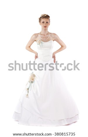 Full length portrait of gorgeous bride wearing wedding dress on white background isolated