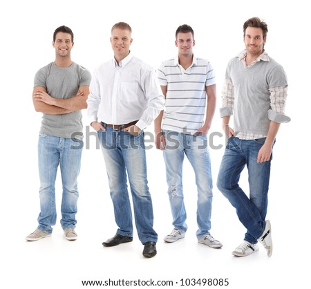 Full-length portrait of group of young men wearing jeans, looking at camera, smiling. - stock photo