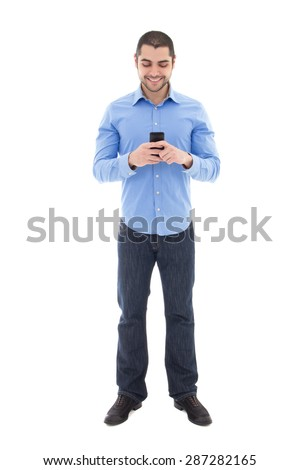 full length portrait of handsome arabic man in blue shirt with smart phone isolated on white background - stock photo