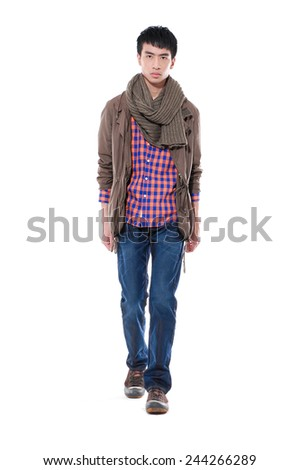 full-length portrait of handsome casual man walking in studio  - stock photo