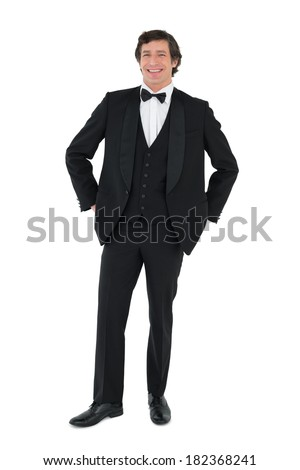 Full length portrait of handsome groom standing over white background