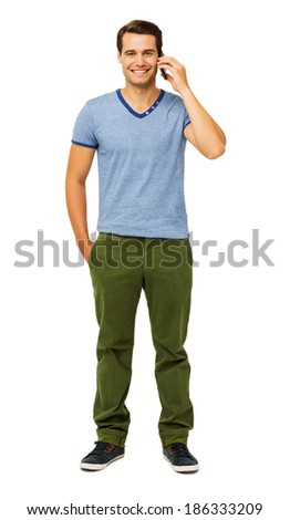 Full length portrait of handsome young man answering smart phone isolated over white background. Vertical shot. - stock photo