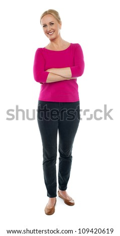 Full length portrait of happy aged woman posing with arms crossed isolated on white background - stock photo