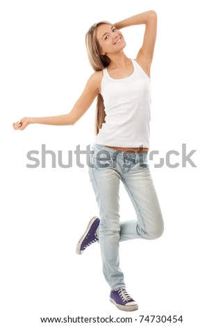 Full length portrait of happy beautiful girl dancing and celebrating, isolated on white background - stock photo