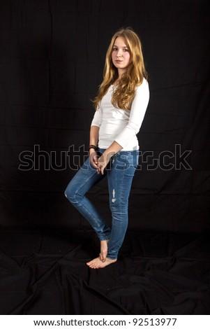 Full length portrait of happy beautiful girl, isolated on black background - stock photo