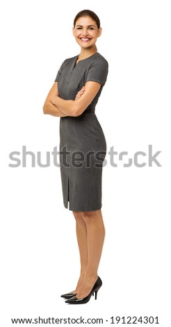 Full length portrait of happy businesswoman with arms crossed isolated over white background. Vertical shot. - stock photo